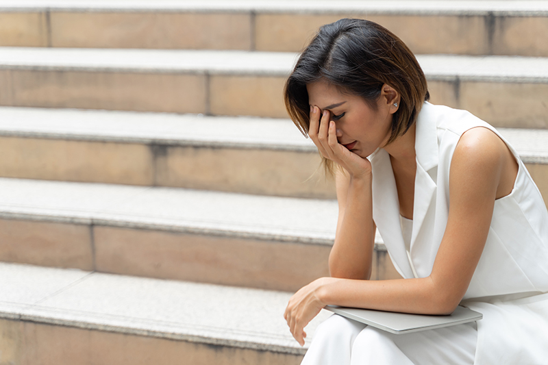 brown woman sad spouse with mental illness health